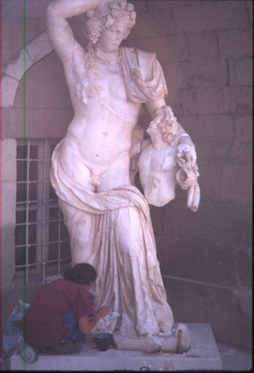 Restoring the colossal statute of Dionysos in Turkey.