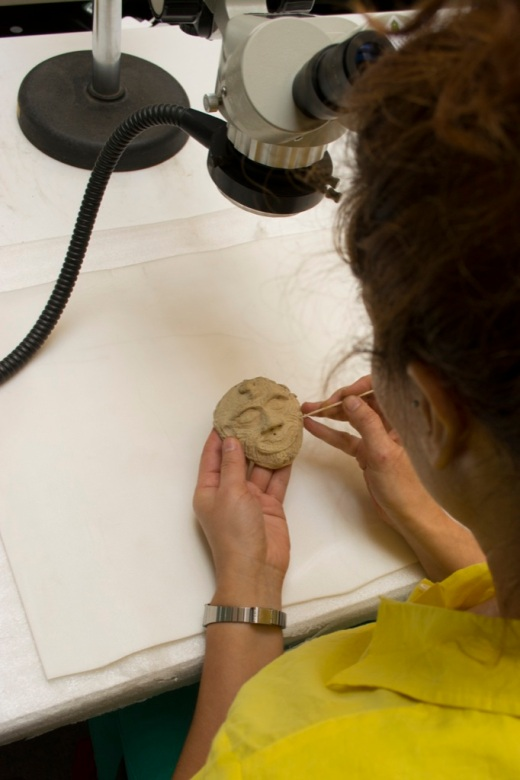 Conserving a terracotta mask from Ur, Iraq (copyright of the British Museum).