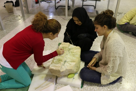 Supervising the  UCL Qatar MSc conservation students on practical conservation work on stone objects. Sheikh Faisal Museum, Doha, Qatar.
