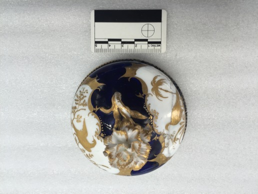 A porcelain lid before conservation. All the photos are the copyright of the British Museum.