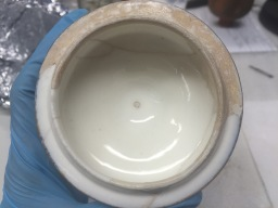 The surface inside the lid after the removal of old restoration paint.