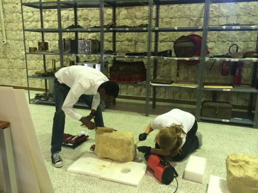 UCL Qatar MSc conservation students working on stone objects. Sheikh Faisal Museum, Doha, Qatar.